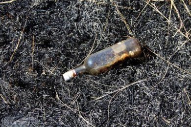 13720170-empty-liquor-bottle-in-burnt-felt-symbolising-alcoholism