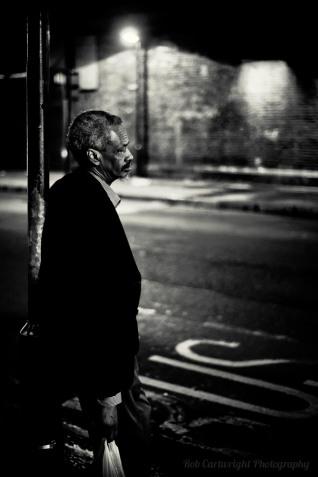 finsbury-park-bus-stop-old-man-elderly-beard-waiting-london-nikon-street-photography-streettogs-city-urban-bw-black-white-bw-monochrome-night-bokeh-rob-cartwright